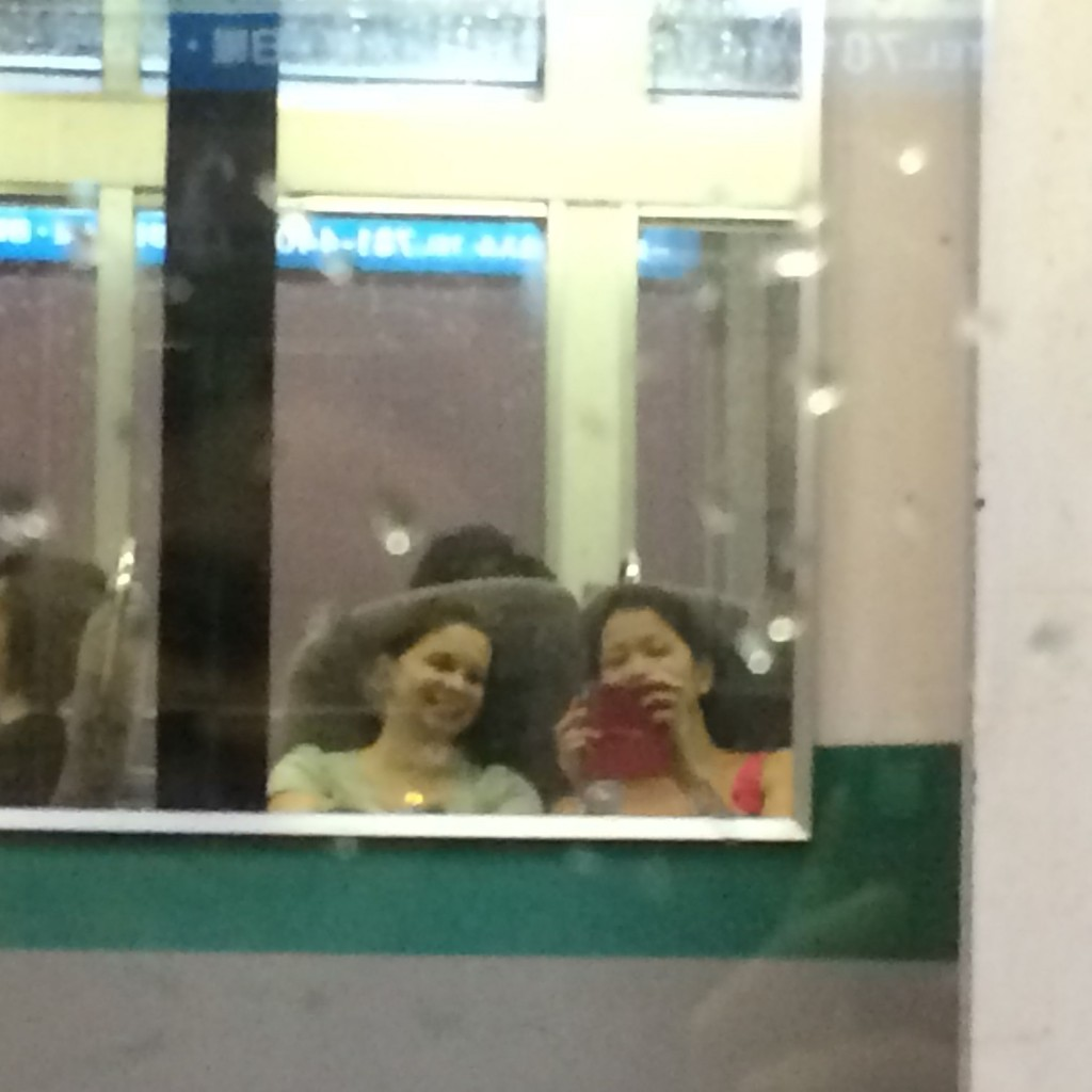 Seeing our reflection in the mirror at one of the train stops!